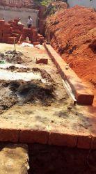 Laterite masonry plinth edge
